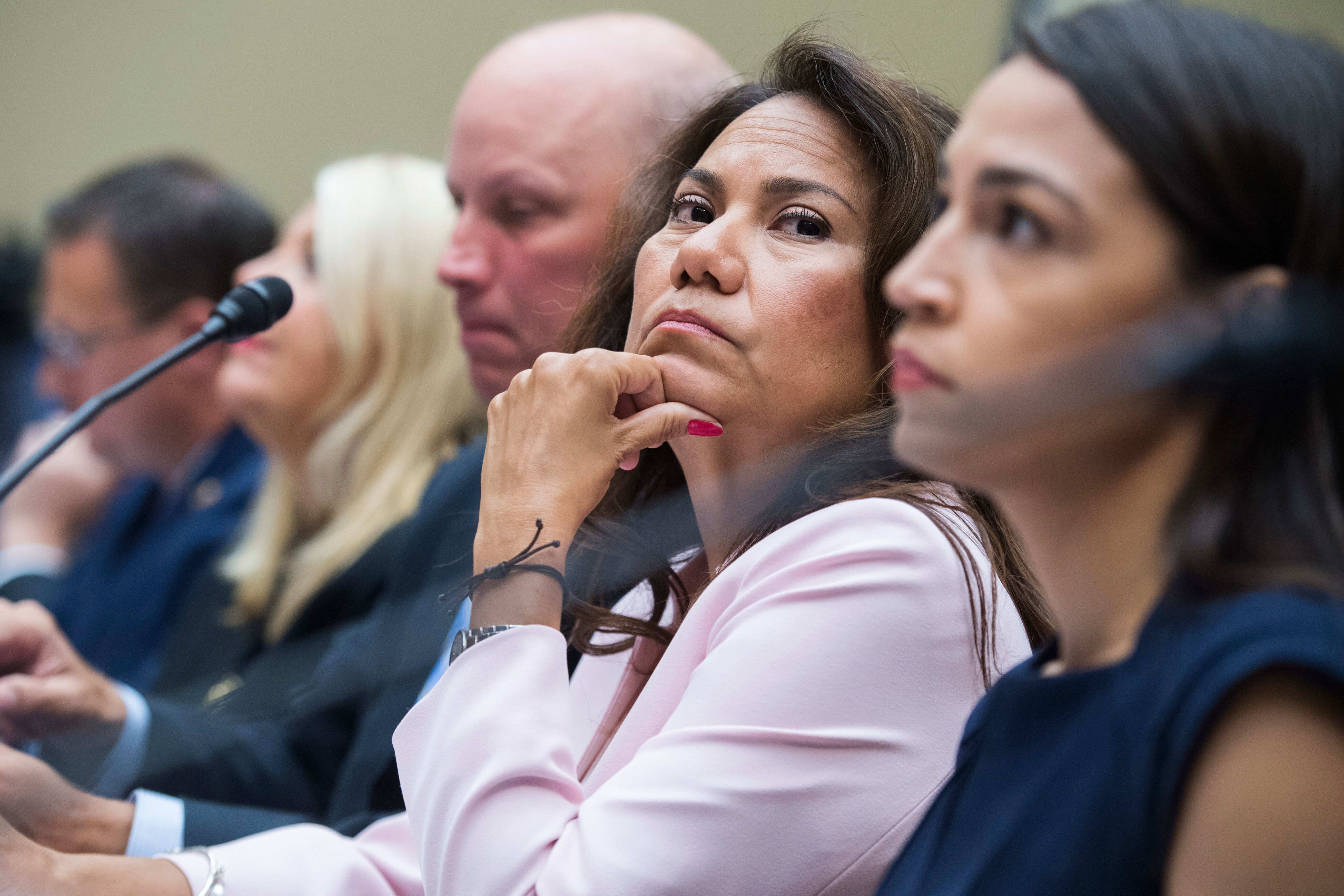 Rep. Veronica Escobar (D-Texas), center, sits on a panel to testify before the House Oversight and Reform Committee about the
