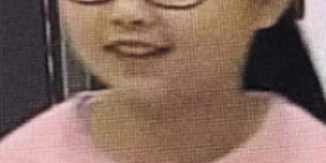 A photograph provided by Xiangshan police of the missing 9-year-old girl Zhang Zixin.