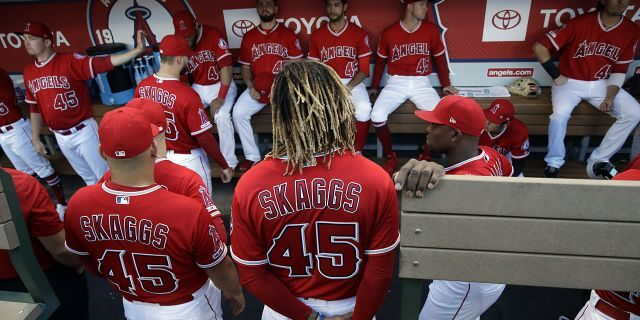 Members of the Los Angeles Angels wear No. 45 in honor of teammate Tyler Skaggs, who died earlier this month, during the team's baseball game against the Seattle Mariners on Friday, July 12, 2019, in Anaheim, Calif. (Associated Press)