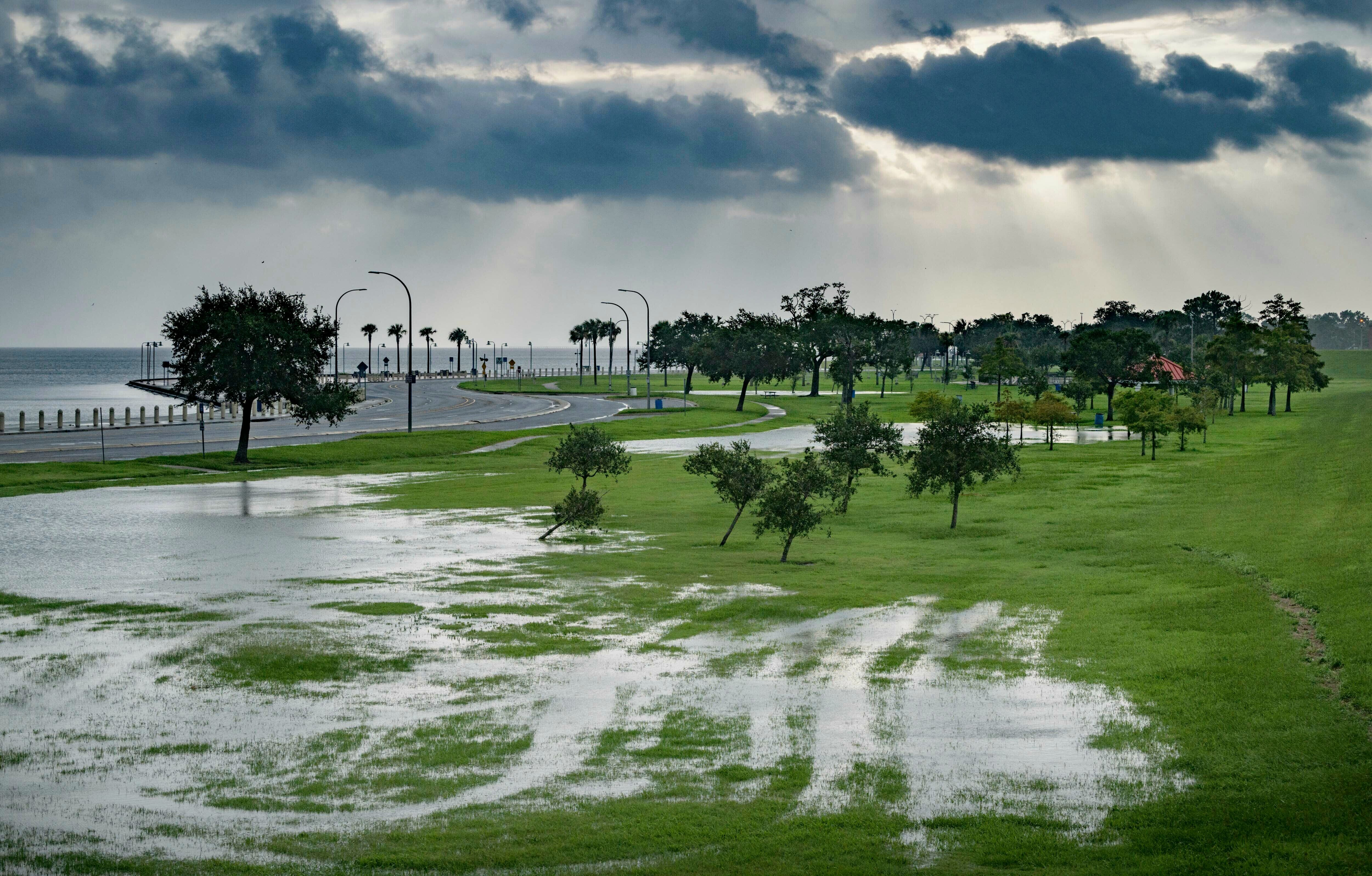 The sky is cloudy as over Lake Pontchartrain on Lakeshore Drive as little flooding is reported in New Orleans, ahead of Tropi