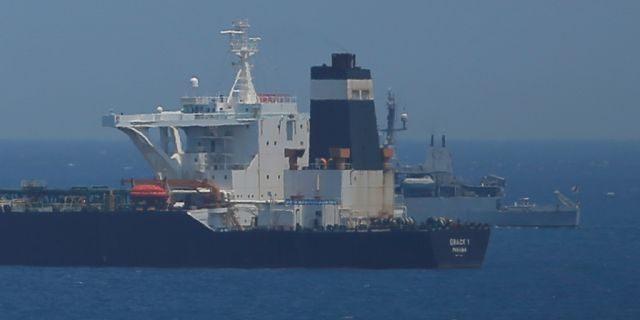 A British Royal Navy patrol vessel guards the oil supertanker Grace 1.