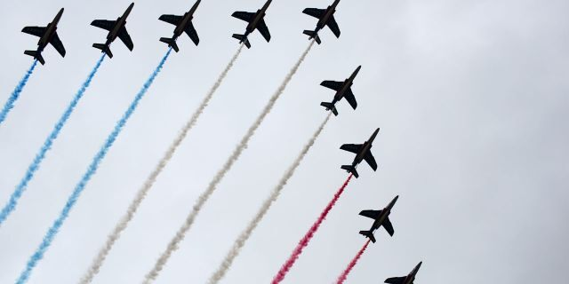 French Alpha jets of the Patrouille de France spray lines of smoke in the colors of the French flag over the Champs-Elysees during Bastille Day parade Sunday, July 14, 2019, near the Champs Elysees avenue in Paris.