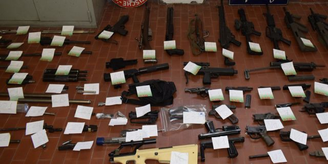 Italian police seized a cache of weapons in their raid.