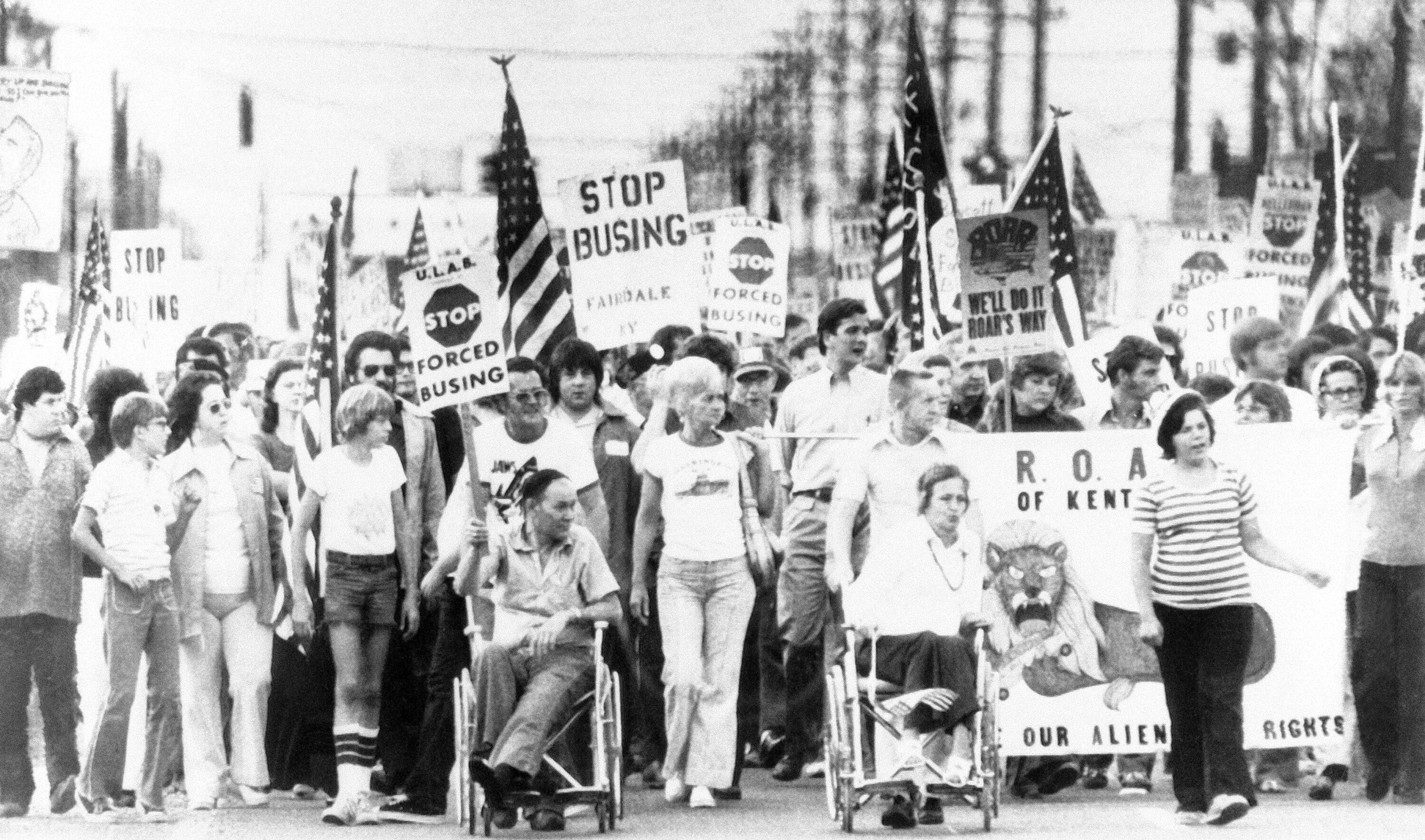 Protesters in southern Jefferson County, Kentucky, march against school desegregation on Aug. 31, 1976, the day before t