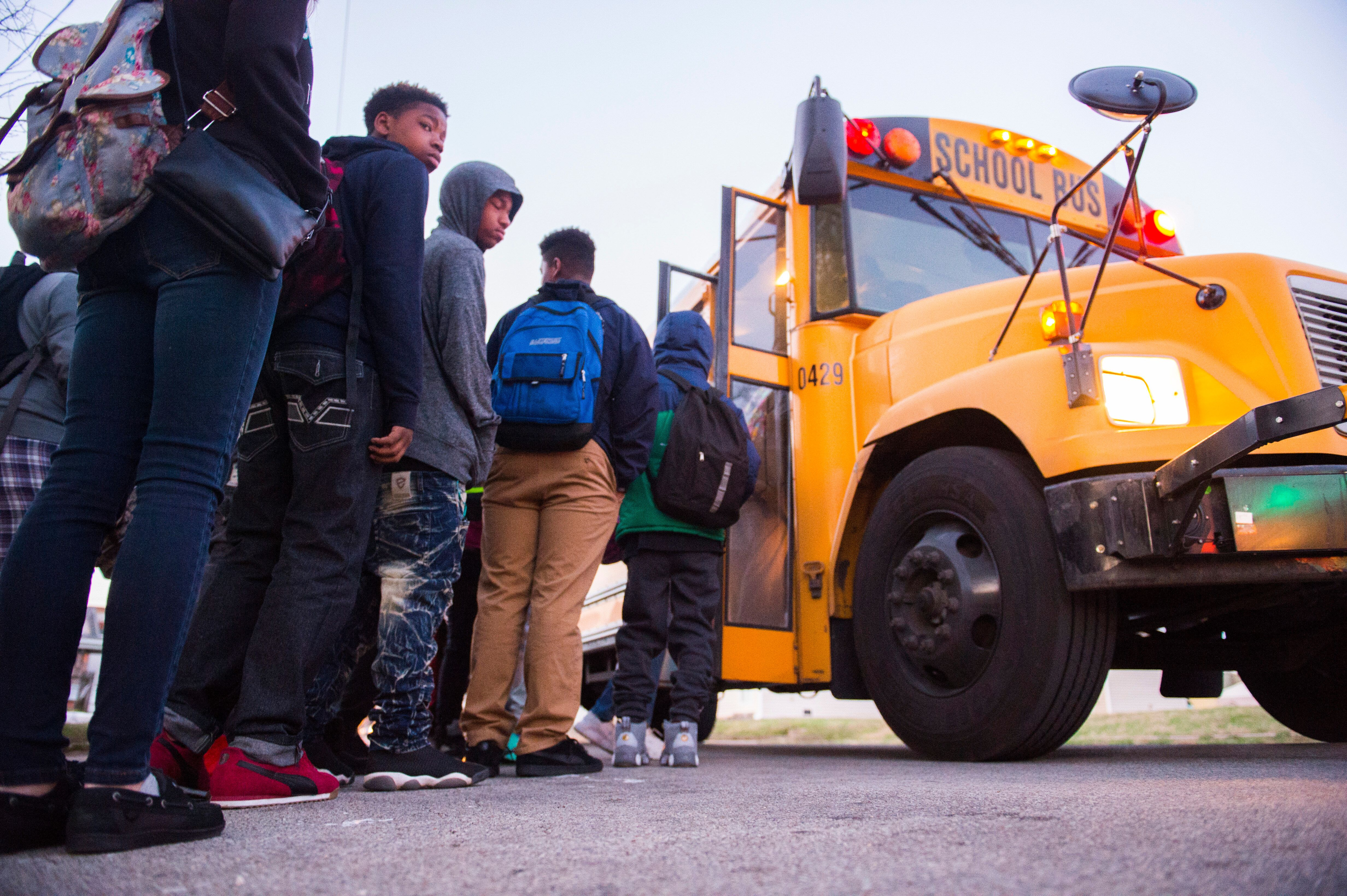 Students board a bus heading to Atherton High School on March, 2, 2017, in Louisville, Kentucky.