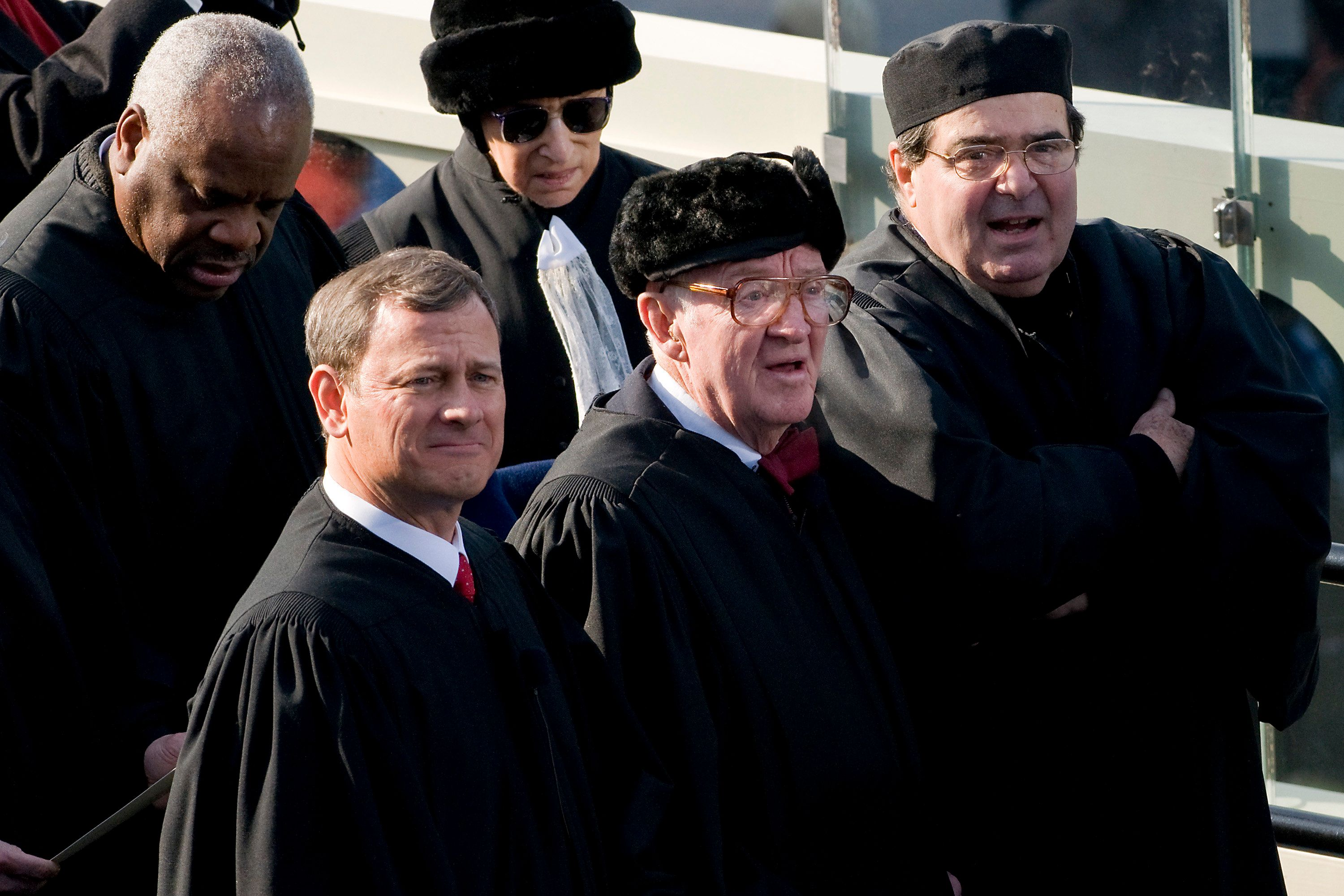 Stevens (center) attends the inauguration of President Barack Obama in 2009. Standing around him (clockwise from his immediat