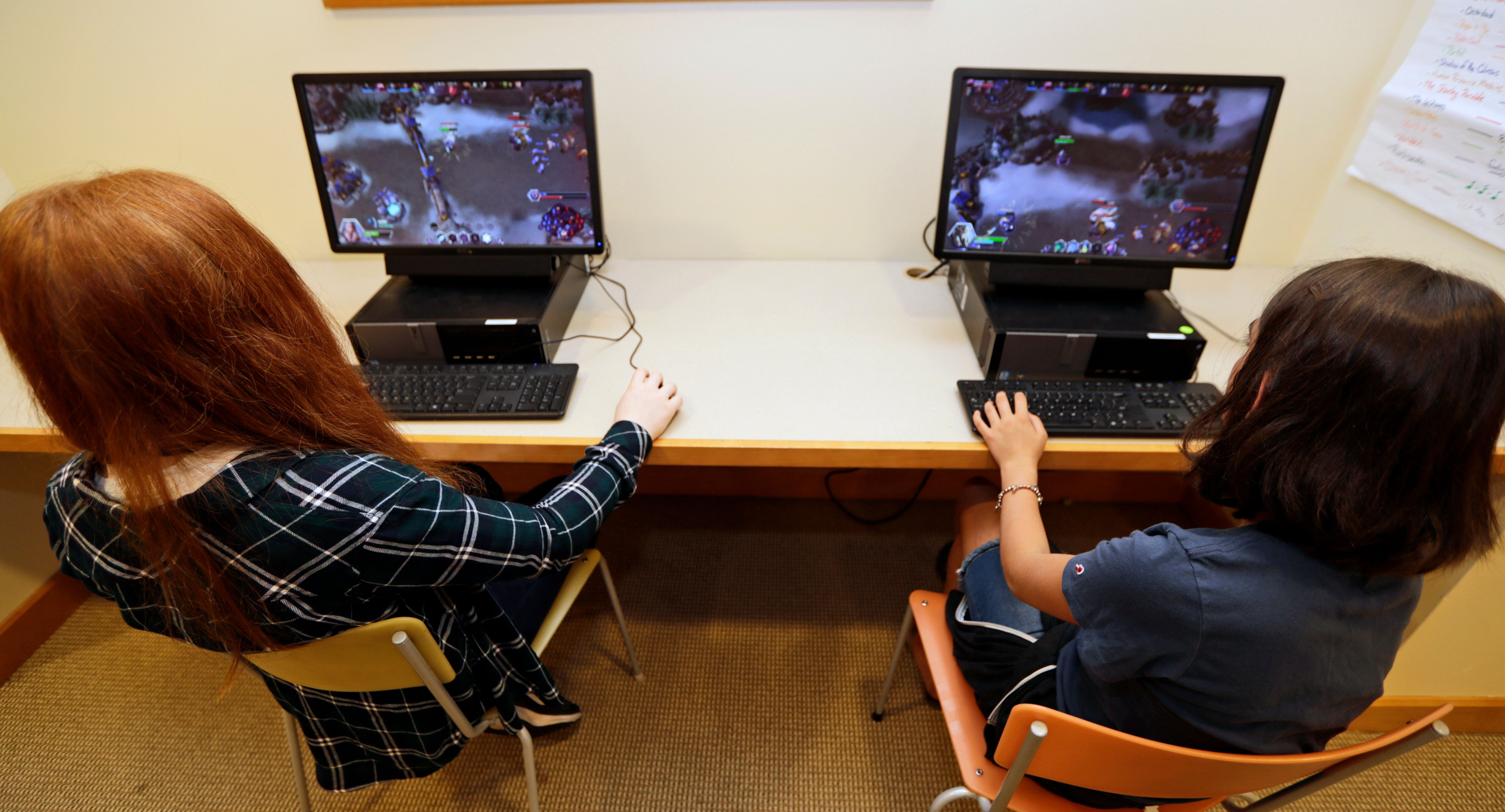 """Claire Hofstra, left, and Kaila Morris play """"Heroes of the Storm,"""" at Hathaway Brown School, Wednesday, July 10, 2019, in Sha"""