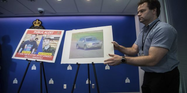 Security camera images of Kam McLeod, 19, and Bryer Schmegelsky, 18, and a Toyota RAV4 SUV are placed on display before an Royal Canadian Mounted Police news conference in Surrey, British Columbia, on Tuesday, July 23, 2019.