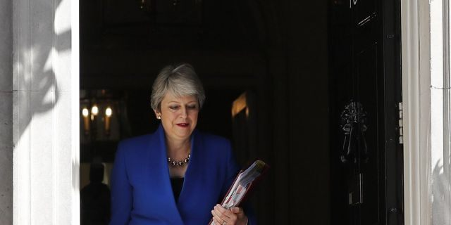 Britain's Prime Minister Theresa May leaves 10 Downing Street, for the House of Commons to attend Prime Minister's Questions in London, Wednesday, July 24, 2019. Boris Johnson will replace May as Prime Minister later Wednesday, following her resignation last month after Parliament repeatedly rejected the Brexit withdrawal agreement she struck with the European Union.
