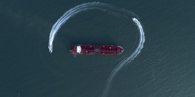 FILE: An aerial view shows a speedboat of Iran's Revolutionary Guard moving around the British-flagged oil tanker Stena Impero which was seized in the Strait of Hormuz on Friday by the Guard, in the Iranian port of Bandar Abbas.