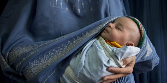 In this Thursday, April 11, 2013 photo, an Afghan woman holds her newly born baby (AP Photo/Anja Niedringhaus)