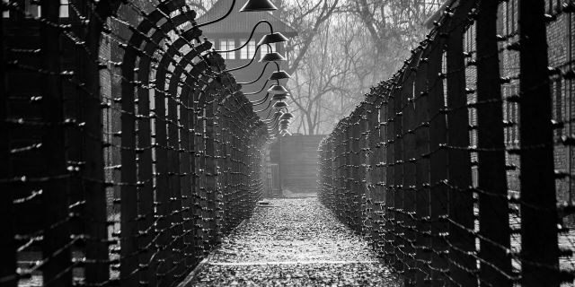 Oswiecim, Poland – March 28, 2016: Electrical fences of Auschwitz - the largest German concentration camp built and operated by the Third Reich in Polish areas annexed by Nazi Germany during World War II. Place of the largest mass murder in a single location in human history.
