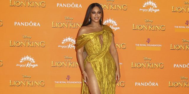 Singer Beyonce poses for photographers upon arrival at the 'Lion King' European premiere in central London, Sunday, July 14, 2019.