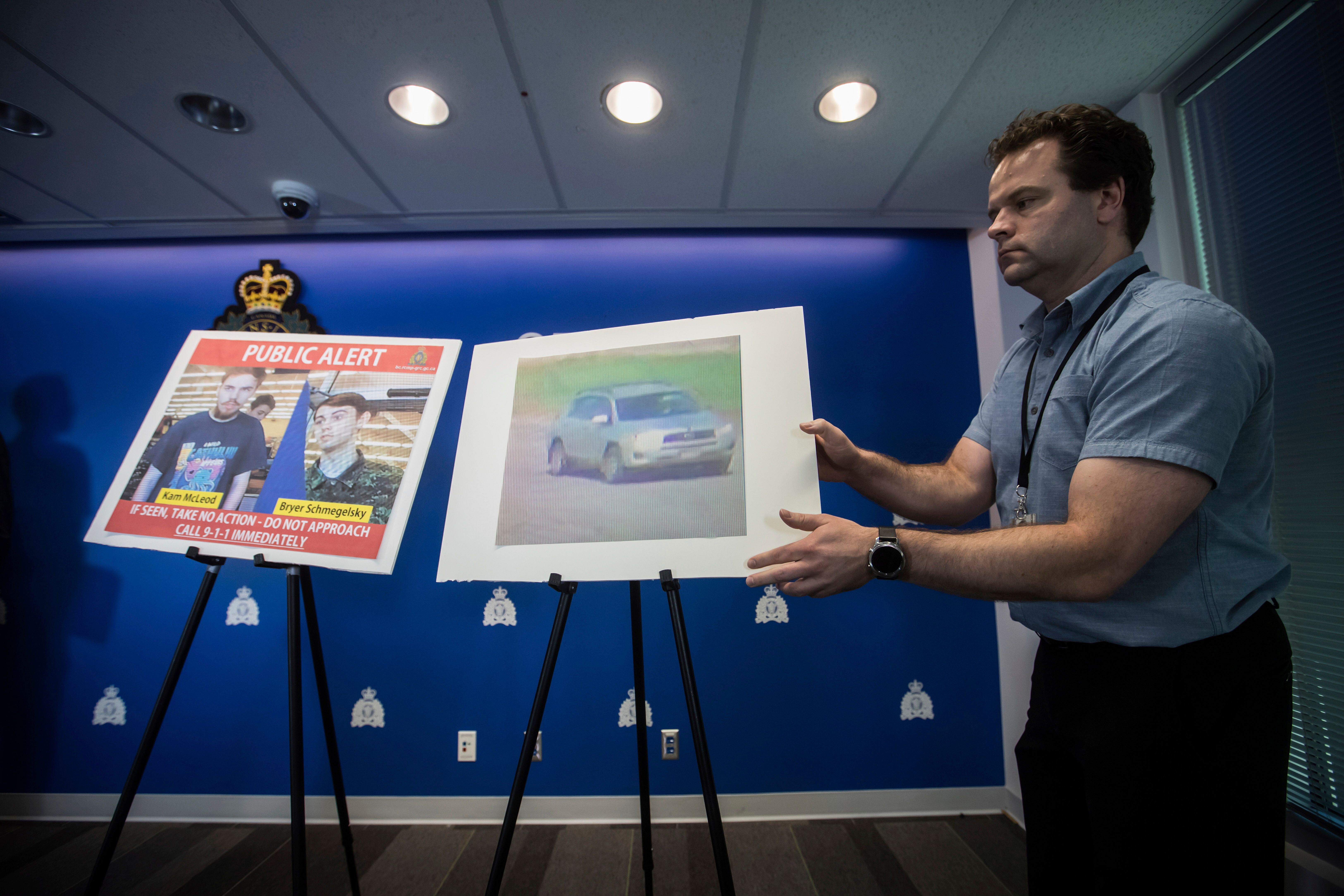 Security camera images of Kam McLeod, 19, and Bryer Schmegelsky, 18, and a Toyota RAV4 SUV are placed on display before an Ro