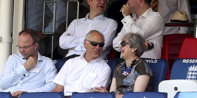 Britain's former Prime Minister Theresa May, right, watches from the stands during the second day of the test match between England and Ireland at Lord's cricket ground in London, Thursday, July 25, 2019. (Bradley Collyer/PA via AP)