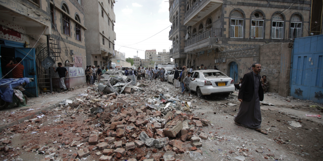 People inspect the site of an airstrike by Saudi-led coalition forces, in Sanaa, Yemen, Thursday, May, 16, 2019. Yemen's human rights minister says heavy fighting is underway in the country's south as rebel Houthis push to gain more territory from government forces and their allies. The clashes come as the Saudi-led coalition carried out airstrikes on the capital, Sanaa, earlier on Thursday, targeting the Houthis and killing at least three civilians. (AP Photo/Hani Mohammed)