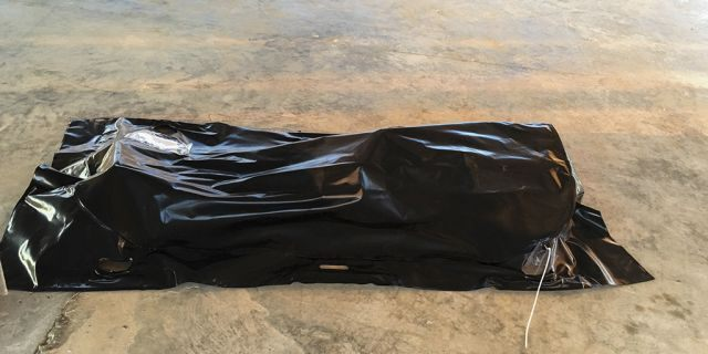 A body of a drowned migrant is seen on a coast some 100 kilometers (60 miles) east of Tripoli, Libya, Thursday, July 25, 2019. The U.N. refugee agency and the International Rescue Committee say up to 150 may have perished at sea off the coast of Libya. The country's coast guard says the Europe-bound migrants are missing and feared drowned after the boats they were traveling on capsized in the Mediterranean Sea. A spokesman says they rescued around 137 migrants on Thursday. (AP Photo/Hazem Ahmed)