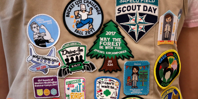 Patches cover the back of a Girl Scout's vest at a demonstration of some of their activities in Seattle, June 18, 2018. (Associated Press)