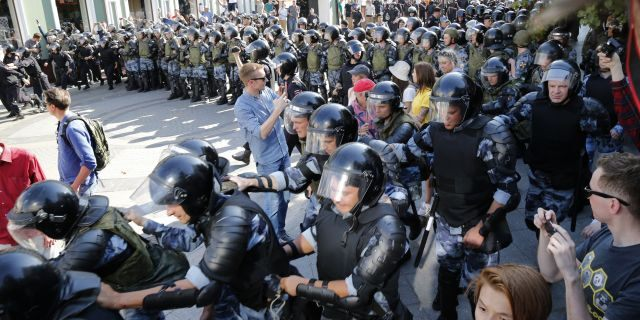 Russian police are wrestling with demonstrators and have arrested hundreds in central Moscow during a protest demanding that opposition candidates be allowed to run for the Moscow city council. (AP Photo/ Alexander Zemlianichenko)