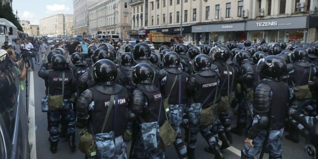 Police block a street during an unsanctioned rally in the center of Moscow during a protest on Saturday. (AP Photo/ Pavel Golovkin)