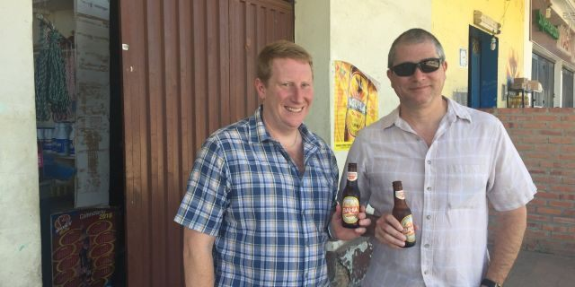 Benjamin Powell and Robert Lawson happily drinking on the Colombian side of the Venezuelan border.
