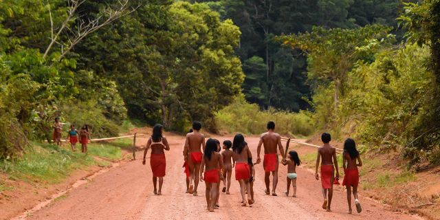 Brazilian Waiapi walk on the road of the Waiapi indigenous reserve, at Pinoty village in Amapa state in Brazil on October 12, 2017. (APU GOMES/AFP/Getty Images)