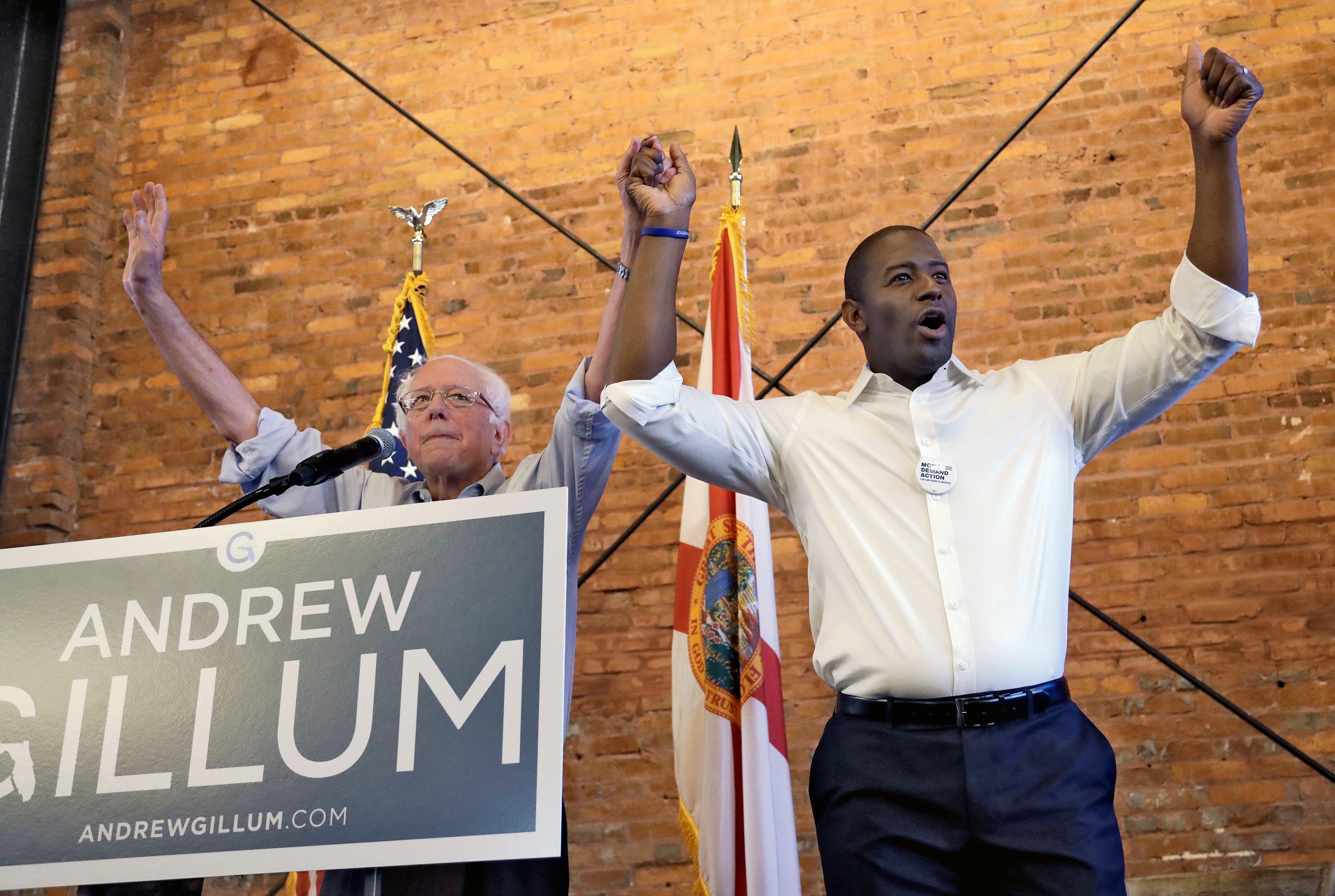 Sen. Bernie Sanders (I-Vt.), left, campaigns for then-Democratic gubernatorial hopeful Andrew Gillum. Sanders' involvement in