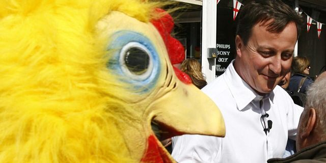 Conservative Party leader David Cameron walks around Tamworth in Staffordshire followed by a man dressed as a chicken, working for the Daily Mirror newspaper. (Photo by Johnny Green/PA Images via Getty Images)