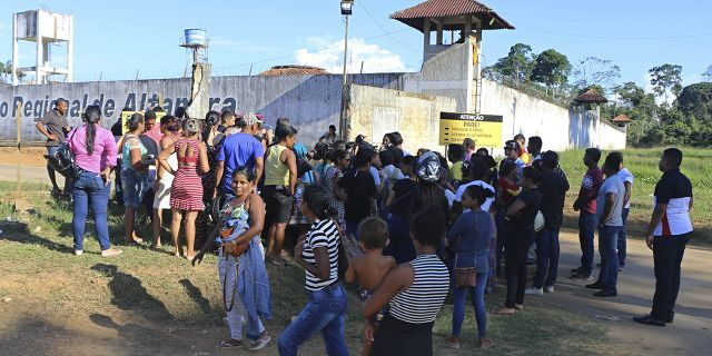People seek information about family members who are prisoners after a riot inside the Regional Recovery Center in Altamira. (Wilson Soares/Panamazonica via AP)