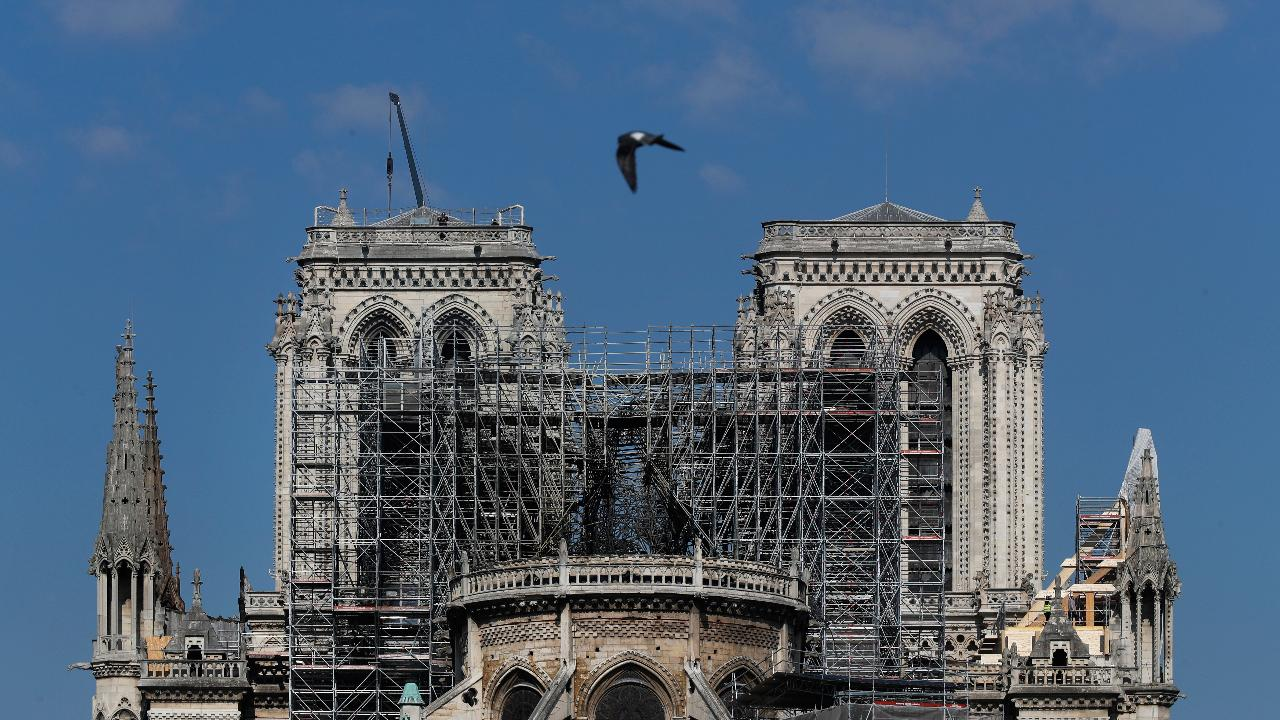 Flames burned iconic Notre Dame church for hours