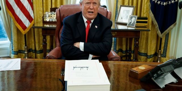 In this Dec. 22, 2017, file photo, President Donald Trump speaks with reporters after signing a tax bill and resolution in the Oval Office of the White House in Washington. California Gov. Gavin Newsom signed a law Tuesday, July 30, 2019, requiring presidential candidates to release their tax returns to appear on the state's primary ballot, a move aimed squarely at Republican President Donald Trump. (AP Photo/Evan Vucci, File)