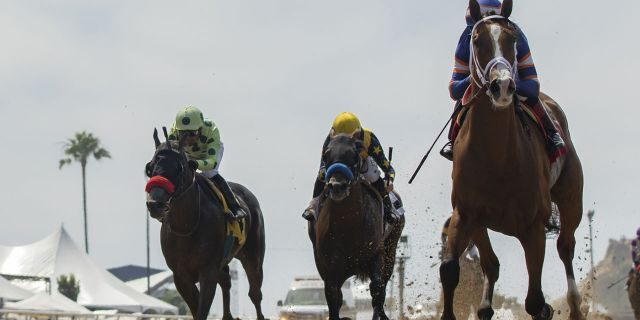 In this image provided by Benoit Photo, Lieutenant Dan, right, with Drayden Van Dyke aboard, outlegs Oliver, left, with Martin Garcia aboard, and Cruel Intention, center, with Joseph Talamo aboard, to win the $150,000 Real Good Deal Stakes horse race Saturday, July 27, 2019, at Del Mar Thoroughbred Club in Del Mar, Calif. (Benoit Photo via AP)