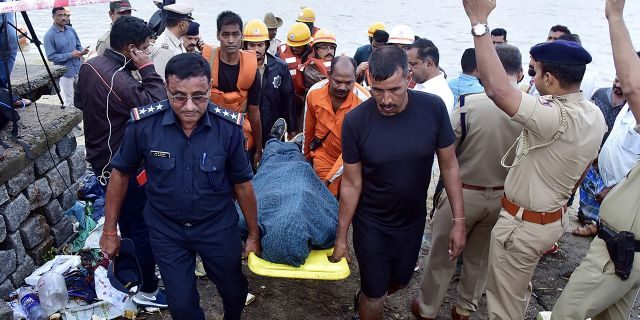 National Disaster Response Force (NDRF) personnel carry the body of missing Indian coffee tycoon V.G. Siddhartha from the banks of Netravati river towards an ambulance after local fishermen found it floating in the coastal city of Mangalore in the southern state of Karnataka on July 31, 2019. (STR/AFP/Getty Images)