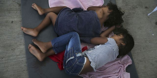 FILE - In this July 17, 2019 file photo, migrant children sleep on a mattress on the floor of the AMAR migrant shelter in Nuevo Laredo, Mexico. The American Civil Liberties Union said Tuesday, July 30, 2019 that more than 900 children have been separated from their families at the border since a judge ordered last year that the practice be sharply curtailed. The ACLU says about one of every five children separated is under 5 years old. (AP Photo/Marco Ugarte, File)
