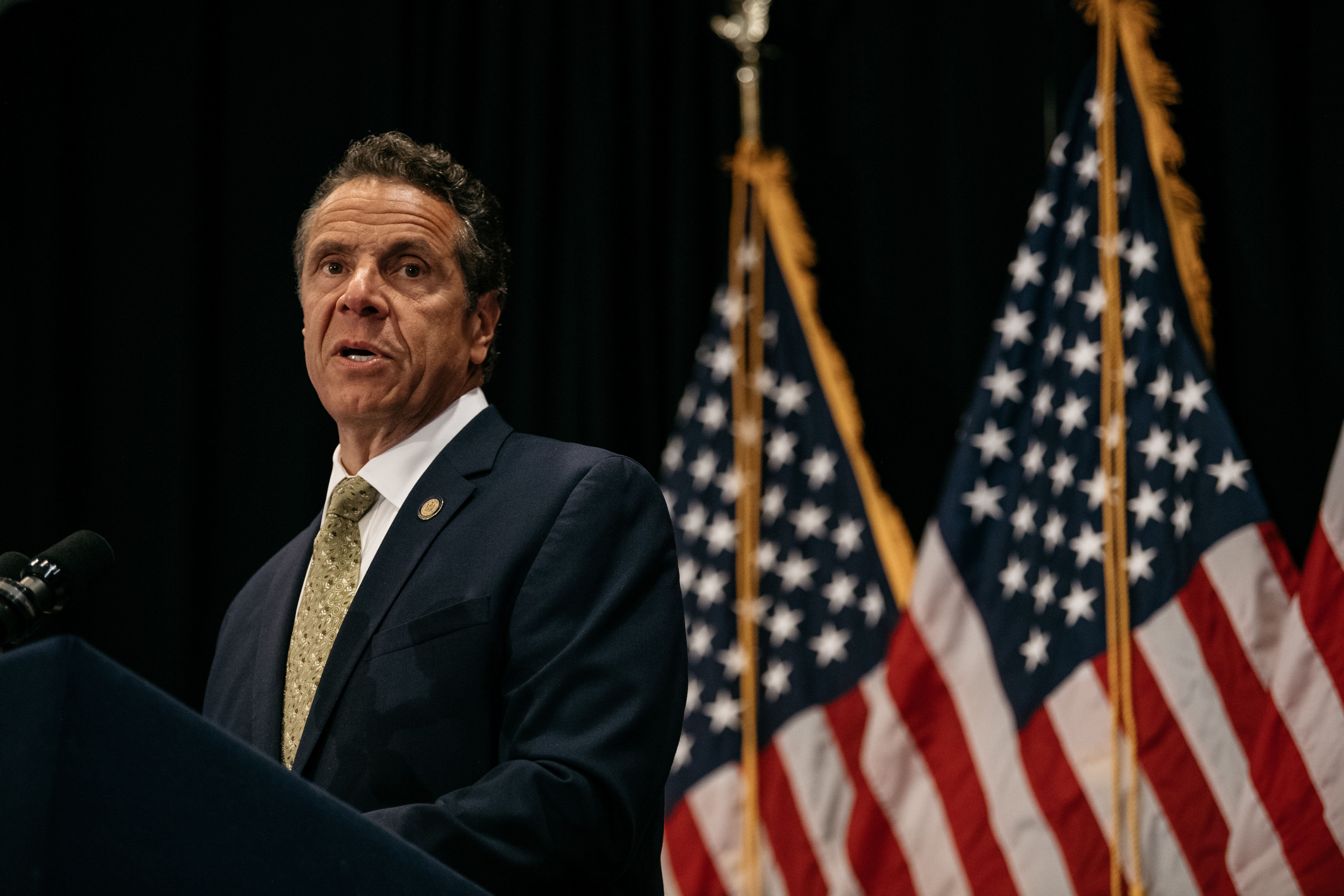 New York Gov. Andrew Cuomo (D) signed a measure Wednesday limiting schools' capacity to arm their staff.