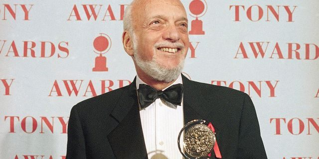 """In this June 4, 1995 file photo, Harold Prince holds his Tony award for best director in a musical for """"Show Boat,"""" at Broadway's Minskoff Theater in New York. Prince, who pushed the boundaries of musical theater with such groundbreaking shows as """"The Phantom of the Oepra,"""" """"Cabaret,"""" """"Company"""" and """"Sweeney Todd"""" and won a staggering 21 Tony Awards, died Wednesday, July 31, 2019, after a brief illness in Reykjavik, Iceland. He was 91."""