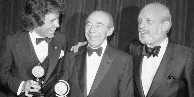"""In this June 4, 1979 file photo, Jack Hofsiss, left, and Hal Prince, right, flank Richard Rodgers at the Tony Award presentations in New York. Prince, who pushed the boundaries of musical theater with such groundbreaking shows as """"The Phantom of the Oepra,"""" """"Cabaret,"""" """"Company"""" and """"Sweeney Todd"""" and won a staggering 21 Tony Awards, died Wednesday, July 31, 2019, after a brief illness in Reykjavik, Iceland. He was 91."""