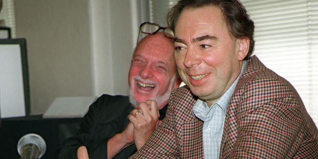 """This Oct. 21, 1996 file photo shows Harold Prince, left, and Andrew Lloyd Webber, face reporters during a news conference in New York announcing Webber's new musical, """"Whistle Down The Wind."""" Prince, who pushed the boundaries of musical theater with such groundbreaking shows as """"The Phantom of the Oepra,"""" """"Cabaret,"""" """"Company"""" and """"Sweeney Todd"""" and won a staggering 21 Tony Awards, died Wednesday, July 31, 2019, after a brief illness in Reykjavik, Iceland. He was 91."""