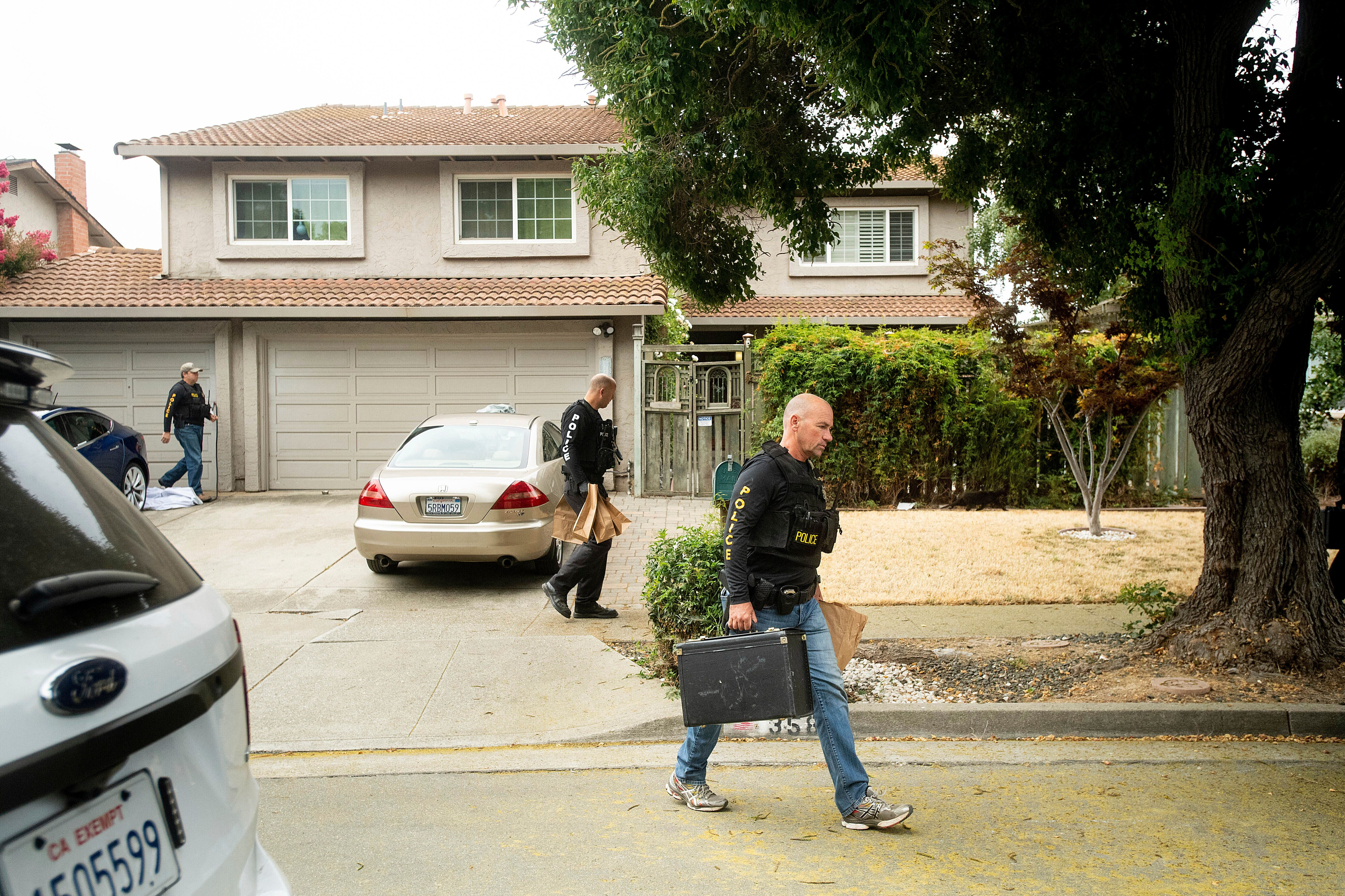 Police officers carry evidence bags from the family home of Gilroy Garlic Festival gunman Santino William Legan, Monday, July