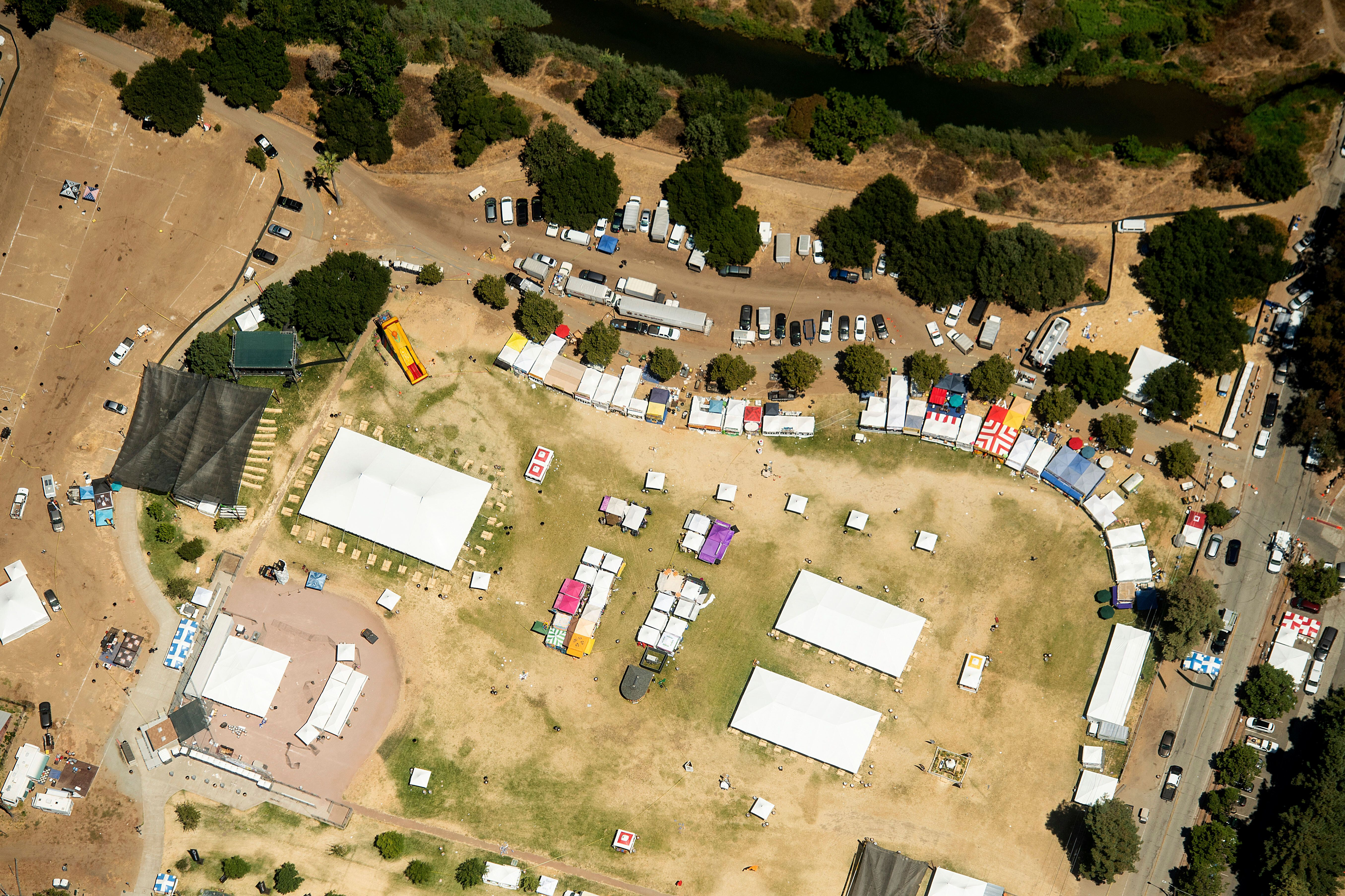 In this aerial photo, vendor booths line Christmas Hill Park, Monday, July 29, 2019, in Gilroy, Calif., the site of a shootin