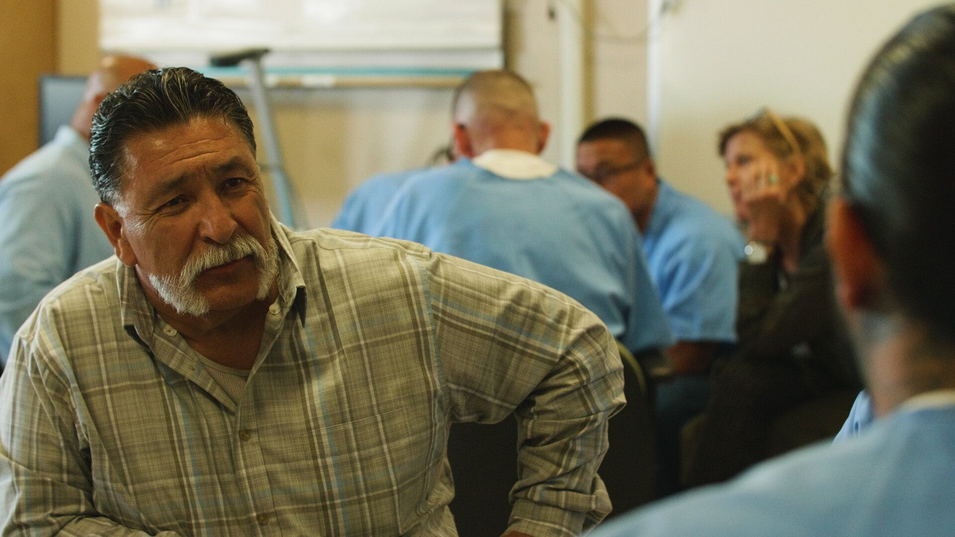 George Luna listening to an inmate during one of the small group breakouts during a GRIP training.