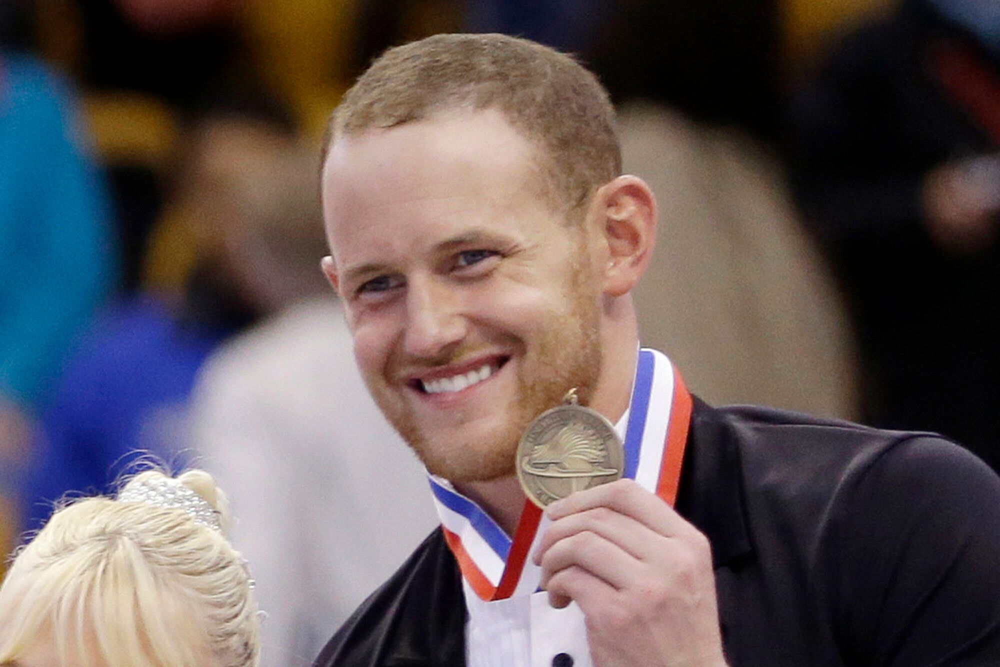 Bronze medalist John Coughlin smiles during a 2014 award ceremony at the U.S. Figure Skating Championships in Boston. Coughli