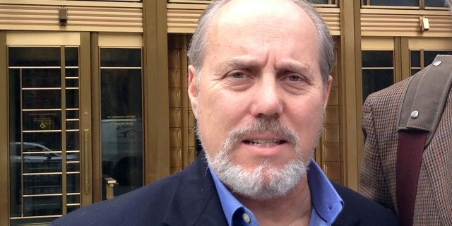 "Ben Sprecher appears outside federal court after swindler Mark Hotton was sentenced to 31 months in federal prison in October 2014. Hotton conned $65,000 from the producers of ""Rebecca; The Musical"" into thinking he'd found them the millionaire investors who could help them open the show on Broadway. Sprecher has now been charged with possession and distribution of child pornography."