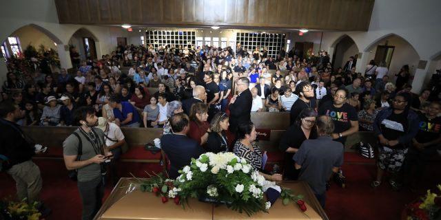 People offering condolences to Antonio Basco, lower right, at her funeral at La Paz Faith Memorial and Spiritual Center in El Paso this past Friday. (AP Photo/Jorge Salgado)