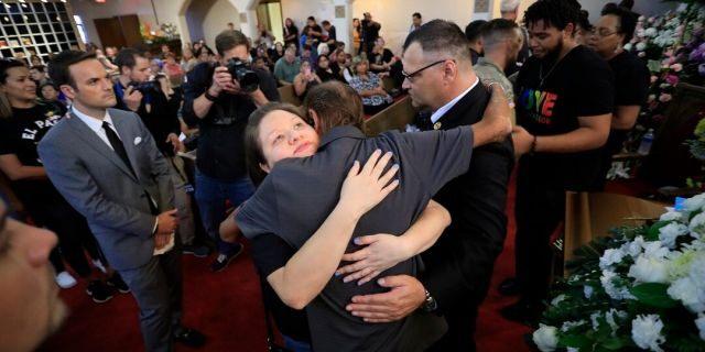 Antonio Basco, center, at her funeral Friday. (AP Photo/Jorge Salgado)