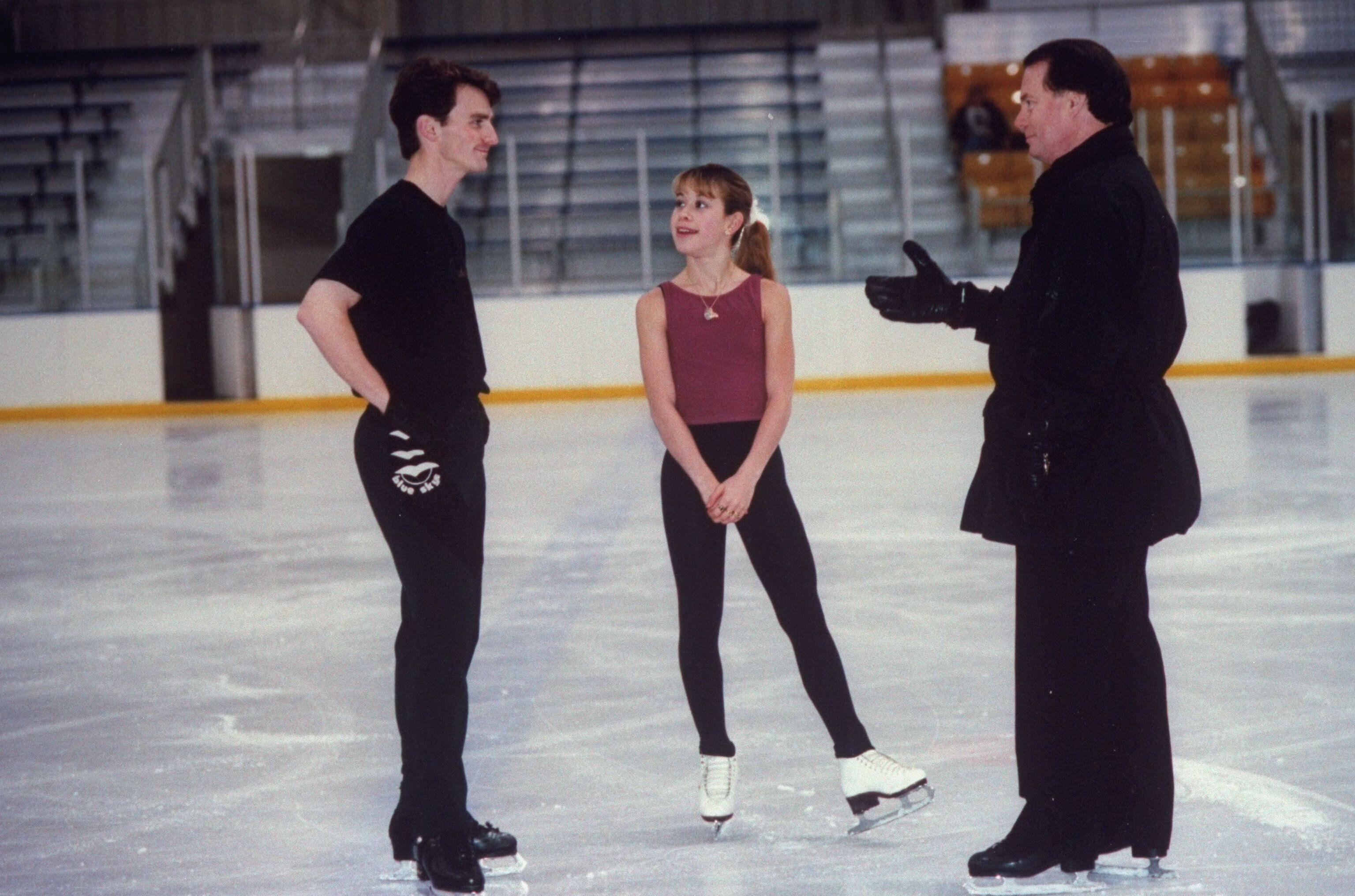Richard Callaghan (right), coaching 1998 Olympic gold medalist Tara Lipinski (center) and 1996 world champion Todd Eldredge (