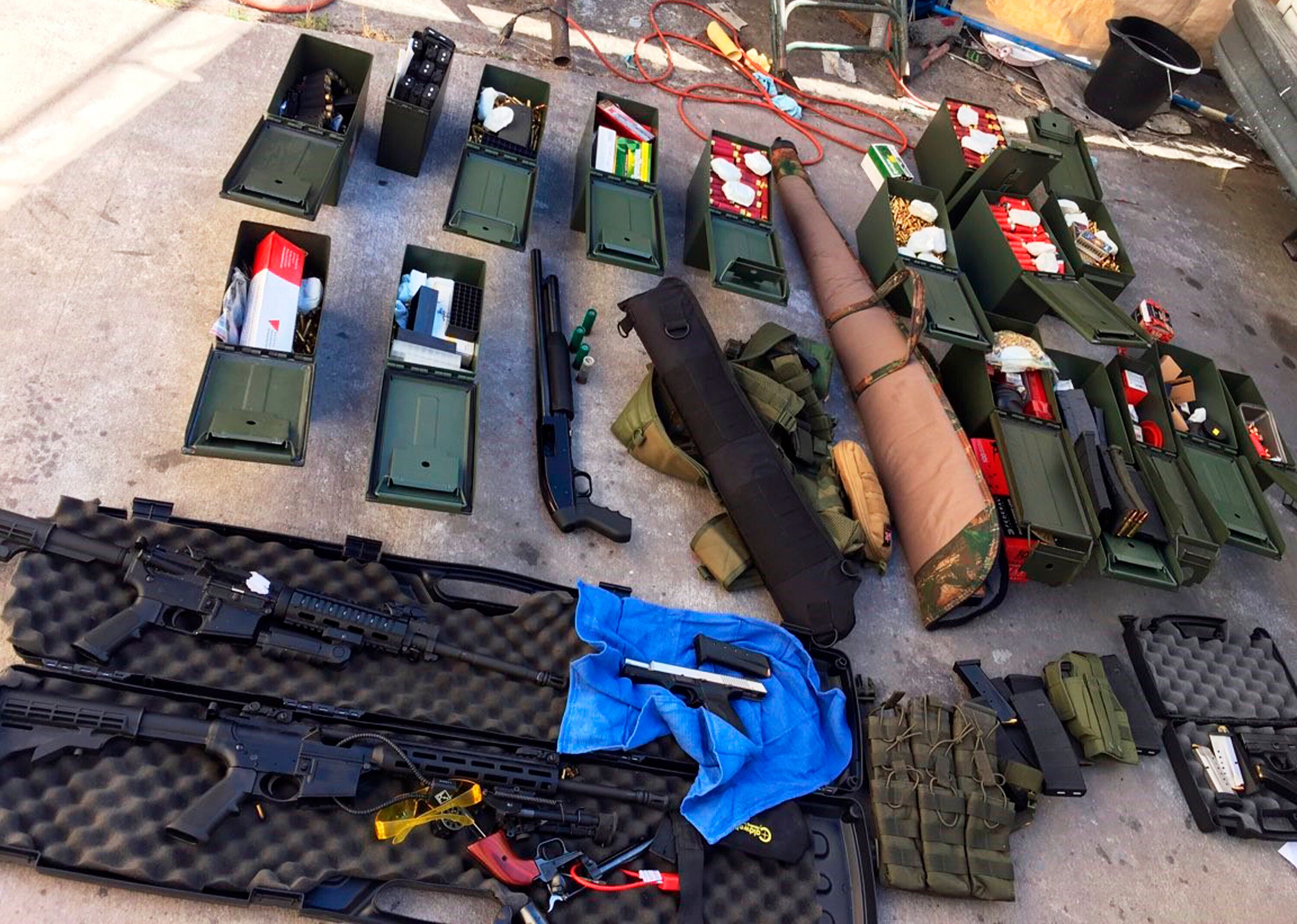 This undated photo released Wednesday, Aug. 21, 2019 by the Long Beach, Calif., Police Department shows weapons and ammunitio