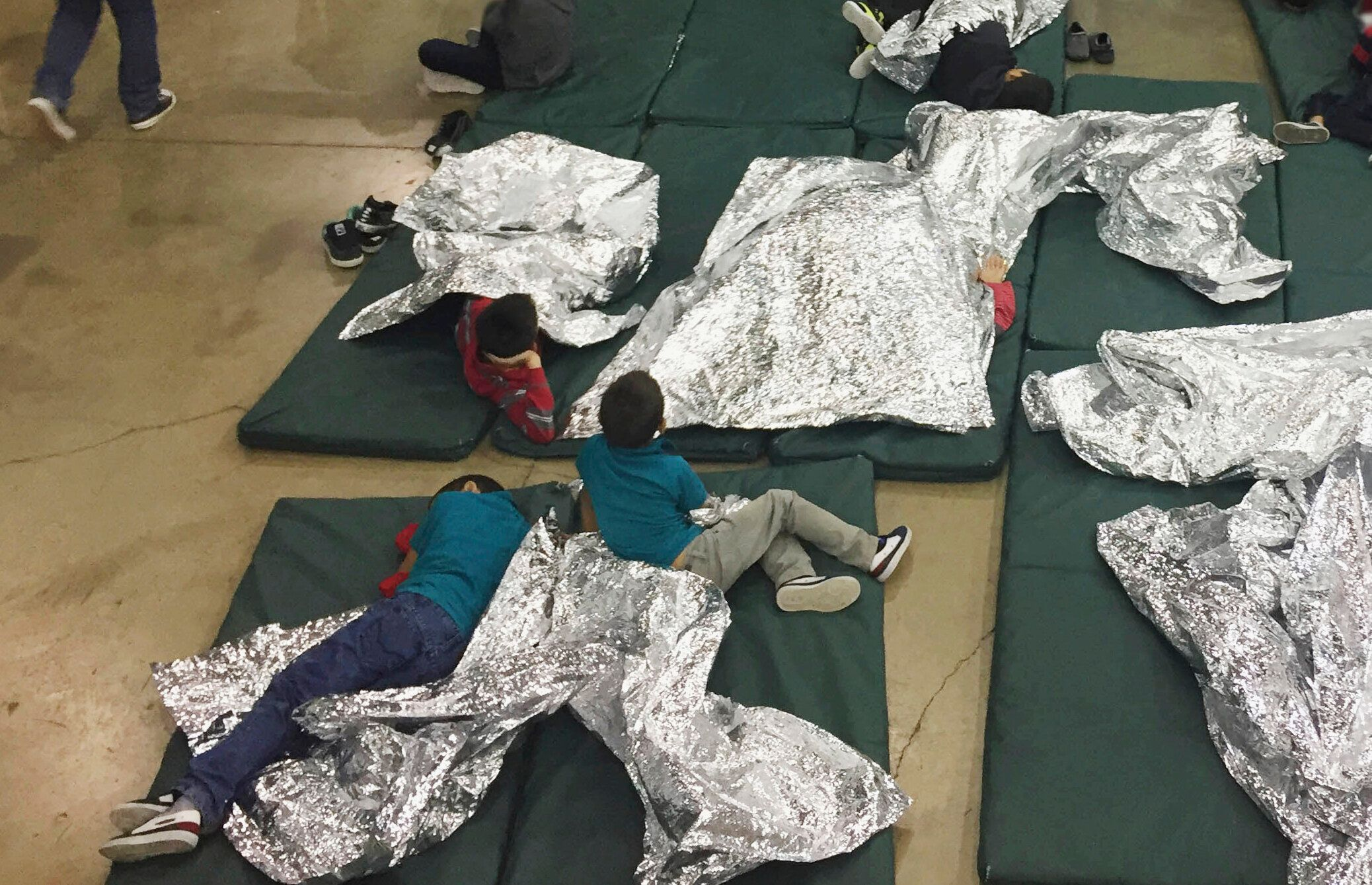 In this Sunday, June 17, 2018, file photo provided by U.S. Customs and Border Protection, people who've been taken into custo