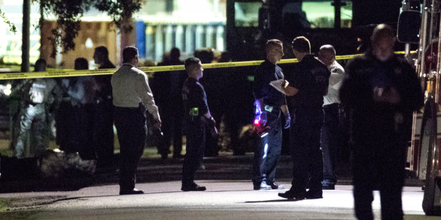 Police respond to the scene of the raid on Jan. 28 of this year. (Brett Coomer/Houston Chronicle via AP File)