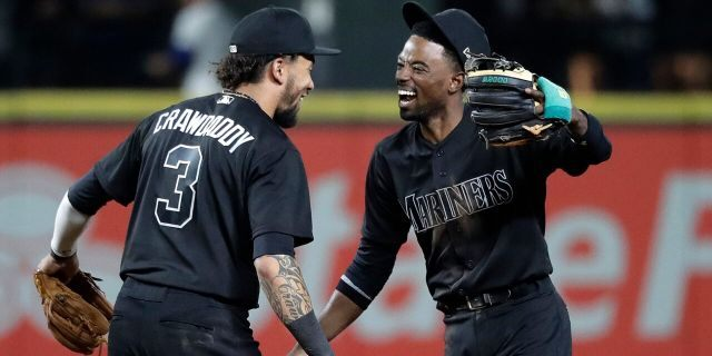 Seattle Mariners' Dee Gordon, right, celebrates with J.P. Crawford after the Mariners beat the Toronto Blue Jays 7-4 in a baseball game, Friday, Aug. 23, 2019, in Seattle. (Association Press)